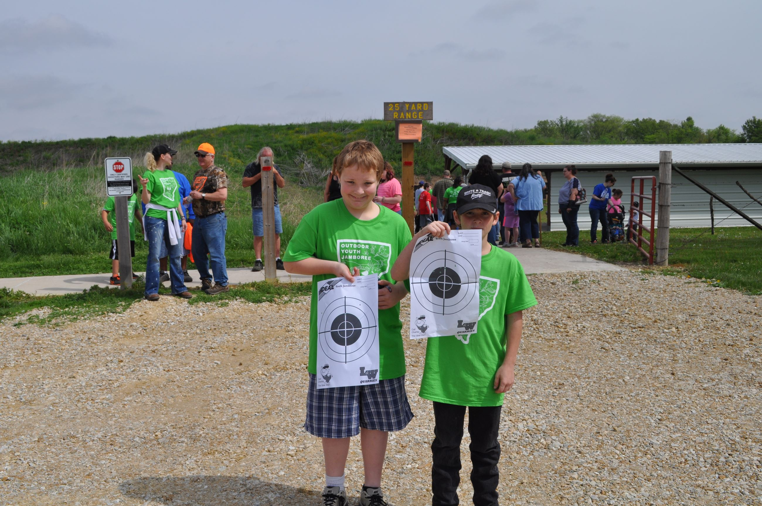 Two kids holding up their targets